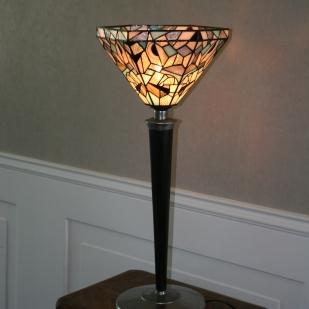 """Elégance, originalité et design pour Tulipa 2, une très grande lampe ancienne à poser des années 30 pour le pied et le socle. Rénovée, son socle initialement revêtu d'une peinture marron foncé a été décapé pour laisser l'acier brut pour un aspect plus contemporain. Le pied en hêtre massif a également été décapé pour être teinté en noir Napoléon et vernis mat. Le luminaire type """"tulipe"""" est constitué de 6 pans en verres motifs contemporains en vitrail Tiffany de couleur blanc, gris, turquoise, noir et transparent striés. Certains verres blancs ont été ornés de dessins naïfs peints à la grisaille et cuits à 650°. Toutes les pièces de verre ont été soigneusement recherchées et sélectionnées pour leur aspect brut et """"torturé"""", ceci pour renforcer le contraste entre l'aspect contemporain de cette lampe et le côté ancien du vitrail Tiffany. Dans le même esprit, les soudures et finitions ont été patinées. Très grande : Hauteur 74 cm, diamètre 33 cm."""