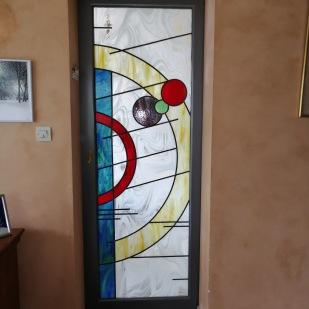 Insertion panneau de Vitrail dans porte coulissante